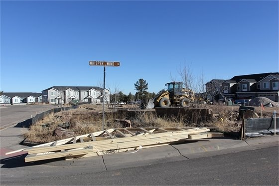 Photo of Enclave Townhomes a residential development site.