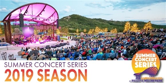 Announcing 2019 Summer Concert Series, picture of stage with people sitting in the lawn