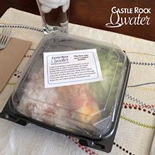 To-go container from Castle Rock Water's To-Go Box Assistance Program
