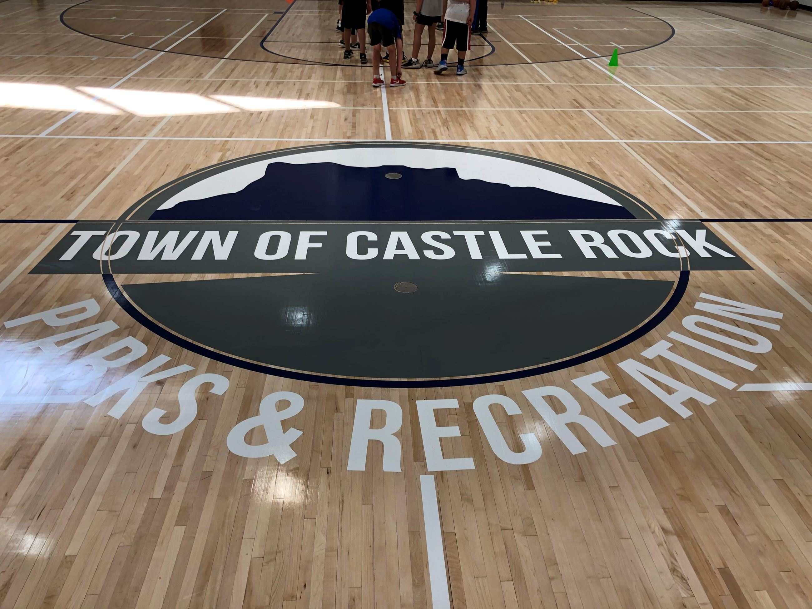 New gym floor featuring the parks and recreation logo